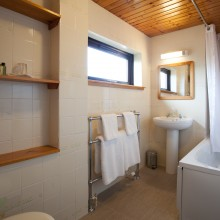 The Garden apartment bathroom with the shower over a full size bath.