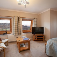 Linnhe suite bedroom with views.