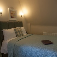 Standard single room with a double bed for comfort.